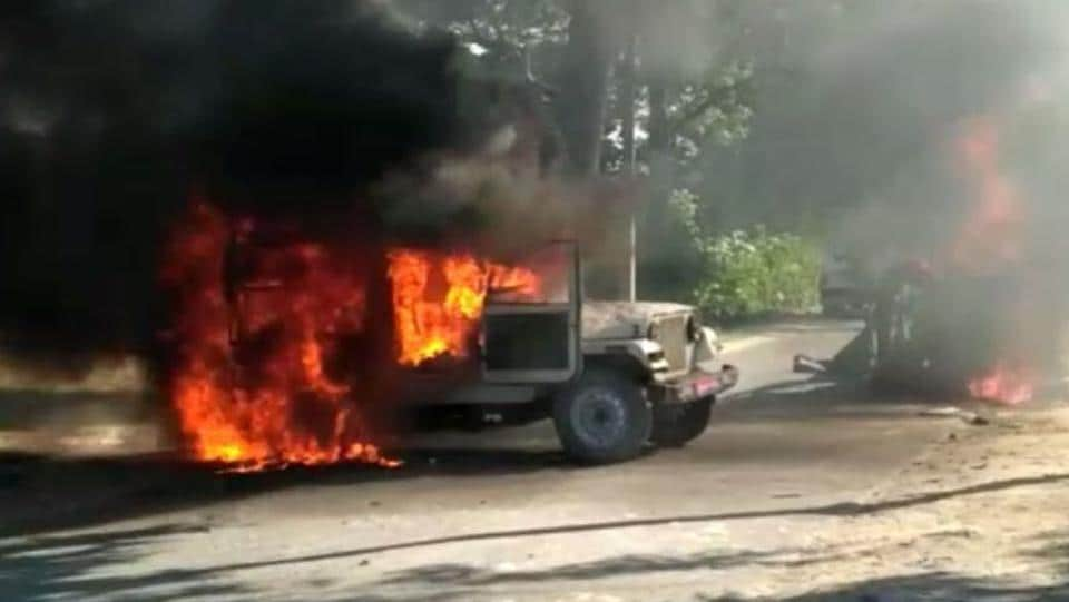 One of the police vehicles that was set on fire by an irate mob in Siwan on Wednesday.