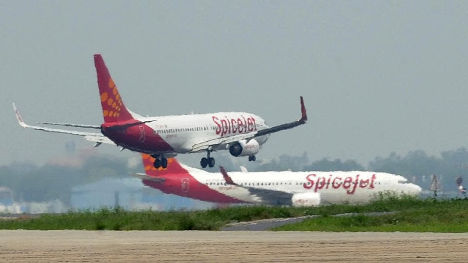 In this photograph taken on July 13, 2011, aircraft from Indian airline Spicejet jostle for space on a runway at Indira Gandhi International Airport in New Delhi.