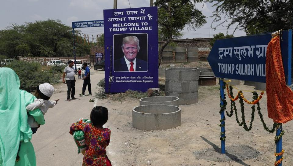 A photograph of US President Donald Trump is displayed at the entrance of Trump Sulabh Village in Marora, India, Friday, June 23, 2017.