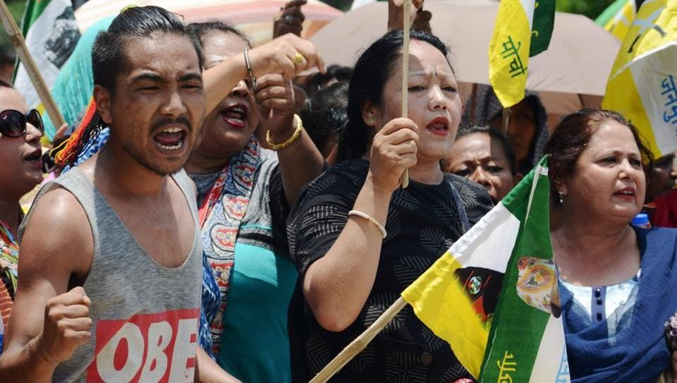 Supporters of the Gorkha Janmukti Morcha (GJM) chant slogans before burning copies of the Gorkhaland Territorial Administration (GTA) agreement during a protest in Dagapur village on the outskirts of Siliguri on June 27, 2017.