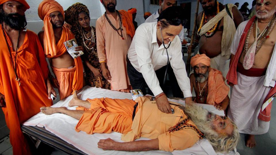 Paramedical staff member examines a Sadhu at a medical camp  in Jammu. 253 health professionals, including 107 doctors and 146 paramedics have been deployed on yatra routes.  (PTI)