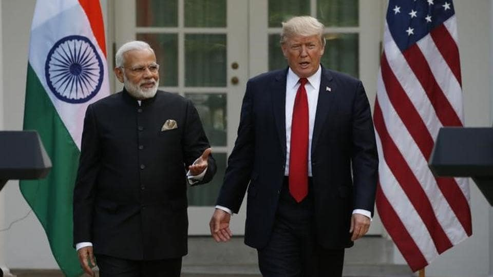 US President Donald Trump (R) arrives for a joint news conference with Indian Prime Minister Narendra Modi in the Rose Garden of the White House in Washington, US, on June 26.
