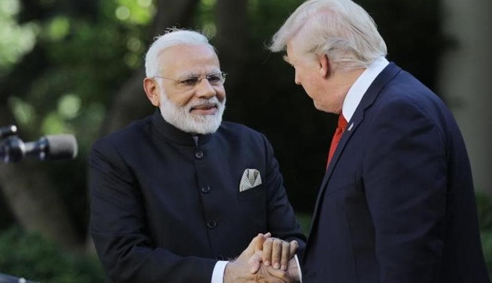 US President Donald Trump (R) greets Indian Prime Minister Narendra Modi during their joint news conference in the Rose Garden of the White House in Washington on June 26.