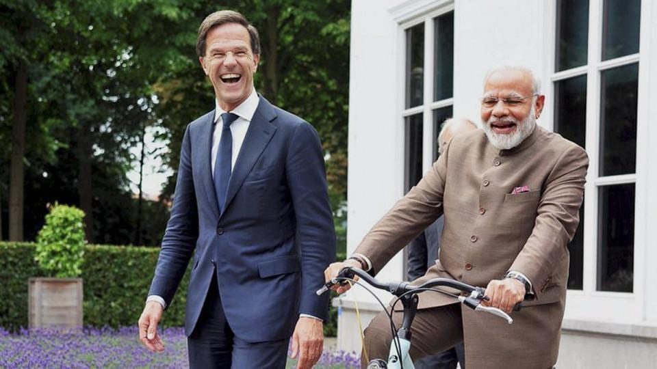Hague : Prime Minister Narendra Modi with the bicycle gifted to him by Dutch Prime Minister Mark Rutte in The Hague, Netherlands on Tuesday.