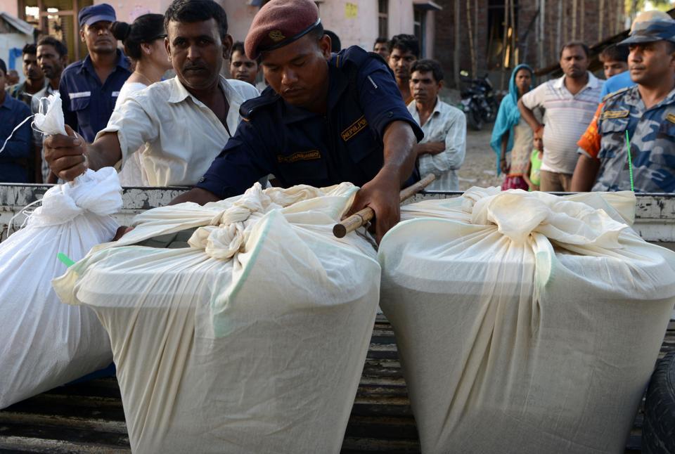 Nepali police load sealed ballot boxes after polling stations close in Nepalgunj, 510 km from Kathmandu.