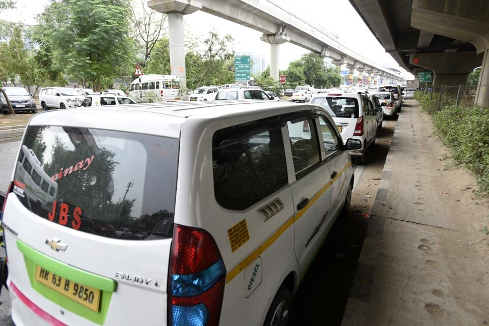 Cab drivers park their vehicles on the stretch in the hope of getting passengers. Many top MNCs and corporate firms have offices in Cyber City.