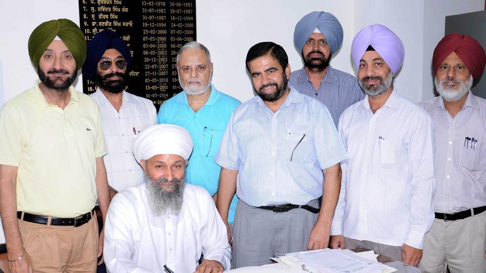 Dr Manjit Singh Nijjar taking charge as registrar of Punjabi University in Patiala on Tuesday.