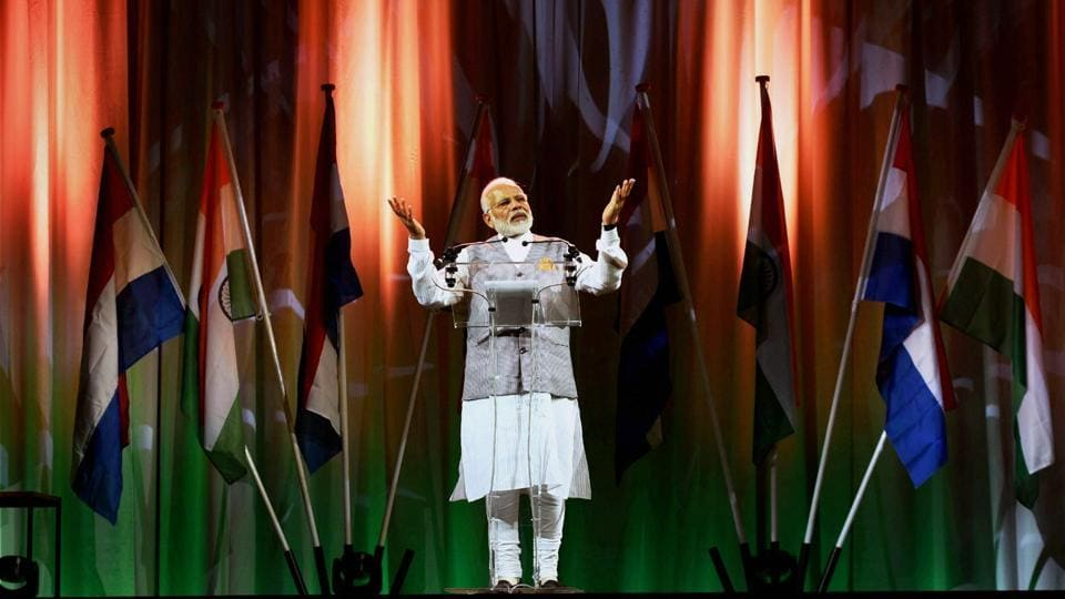Prime Minister Narendra Modi addresses members of the Indian community at the Hague, Netherlands, on Tuesday.