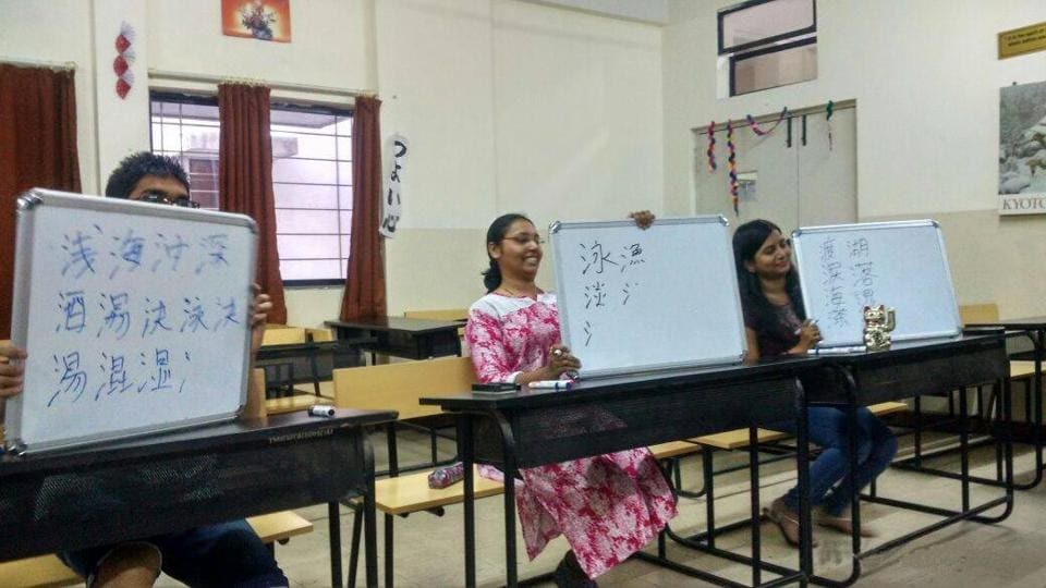 Students learning Japanese in a classroom  in Pune.