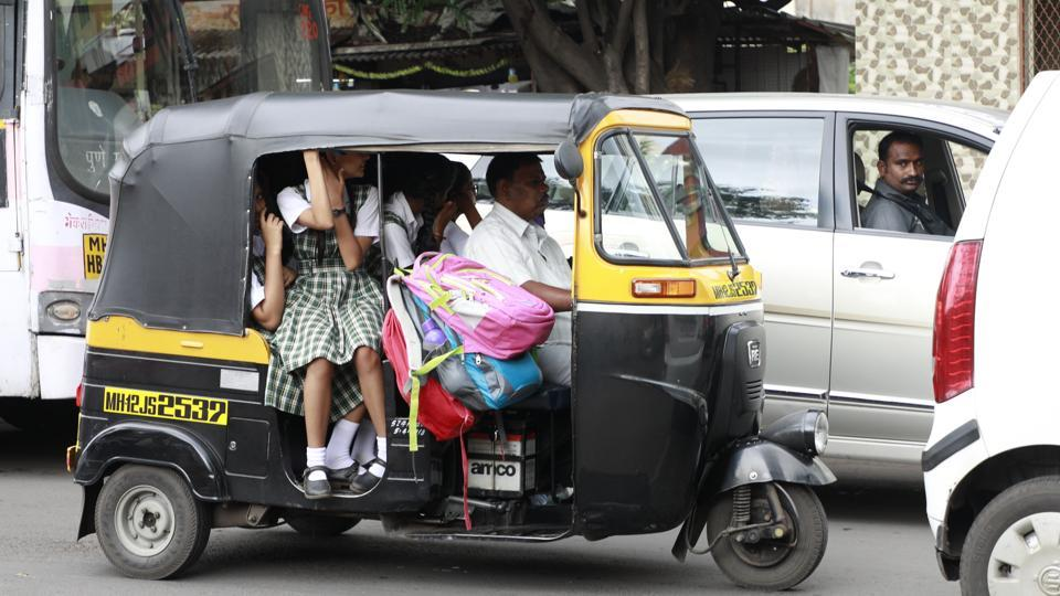 Autorickshaws usually overload the vehicle while transporting students to school in Pune.