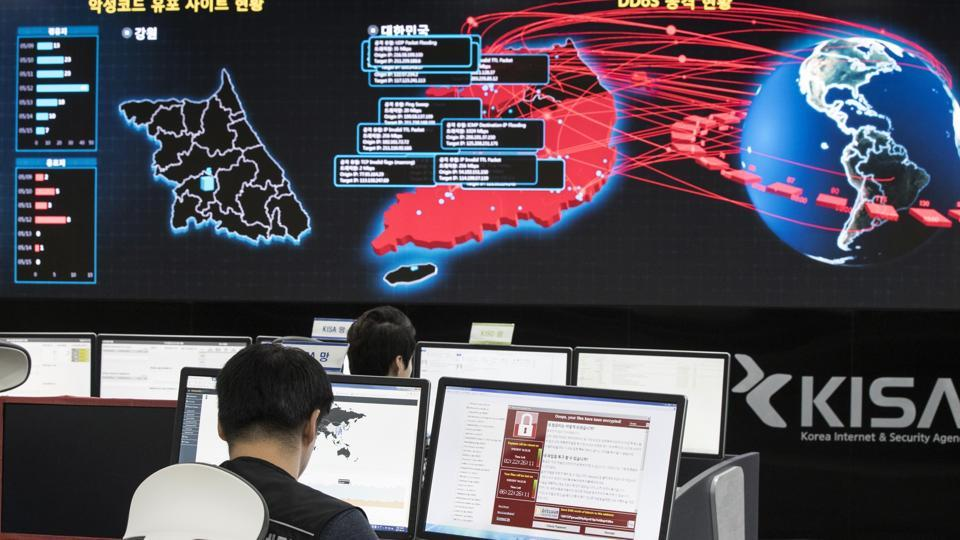 In this Monday, May 15, 2017, file photo, employees watch electronic boards to monitor possible ransomware cyberattacks at the Korea Internet and Security Agency in Seoul, South Korea.