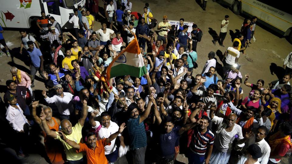 Devotees chant religious slogans as the first batch of Hindu pilgrims leave for Amarnath Yatra. (Nitin Kanotra/HT Photo)