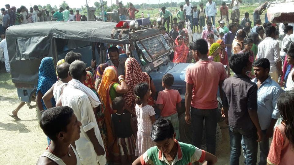 Police at Sitamarhi village where two men forced their mother to drink human excreta