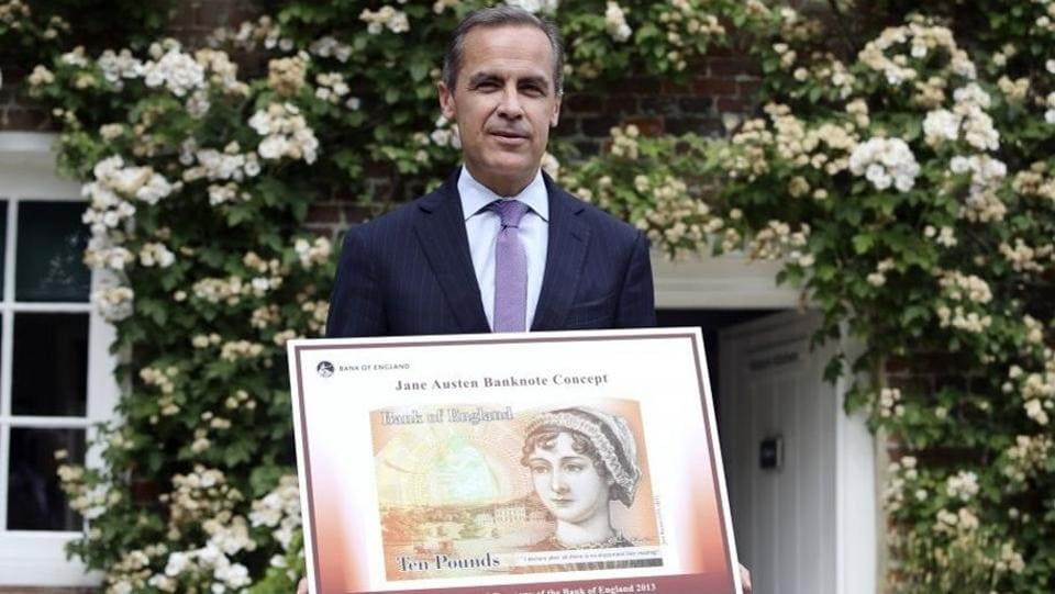 Governor of the Bank of England, Mark Carney, holding the concept design for the new Bank of England £10 note featuring Jane Austen.