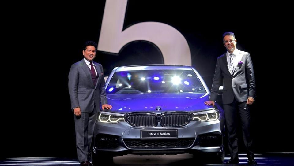 Sachin Tendulkar (L) and Vikram Pawah, president of BMW Group India with the all-new BMW 5 Series.
