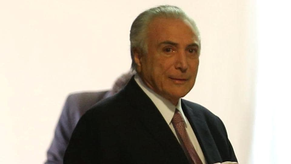 Brazilian President Michel Temer arrives for a press statement, at Planalto Palace in Brasilia, June 27, 2017.