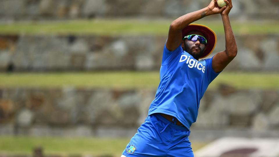West Indies' Devendra Bishoo catches a ball during practice at the Sir Vivian Richards Cricket Ground, where they will host India in the 3rd ODI. (AFP)
