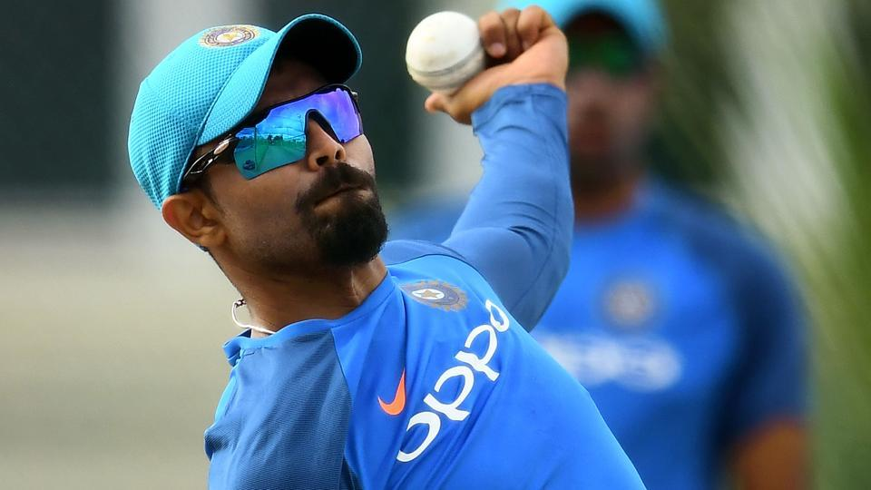India's Ravindra Jadeja delivers a ball during a practice session at the Sir Vivian Richards Cricket Ground in St. John's, Antigua.