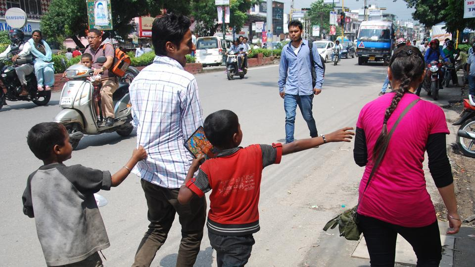 Child beggars in Dehradun seeking alms.