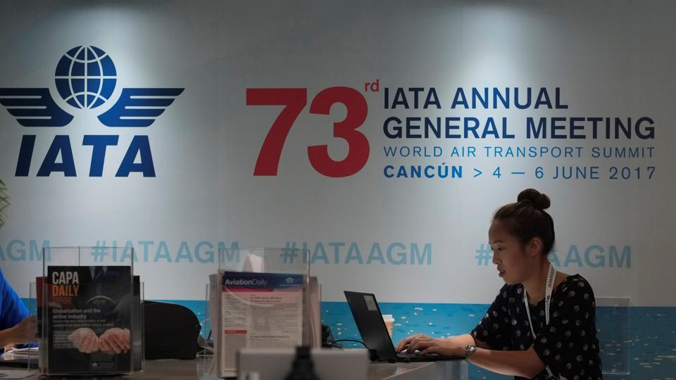 A woman uses a laptop at a meeting of the International Air Transport Association (IATA) in Cancun, Mexico.