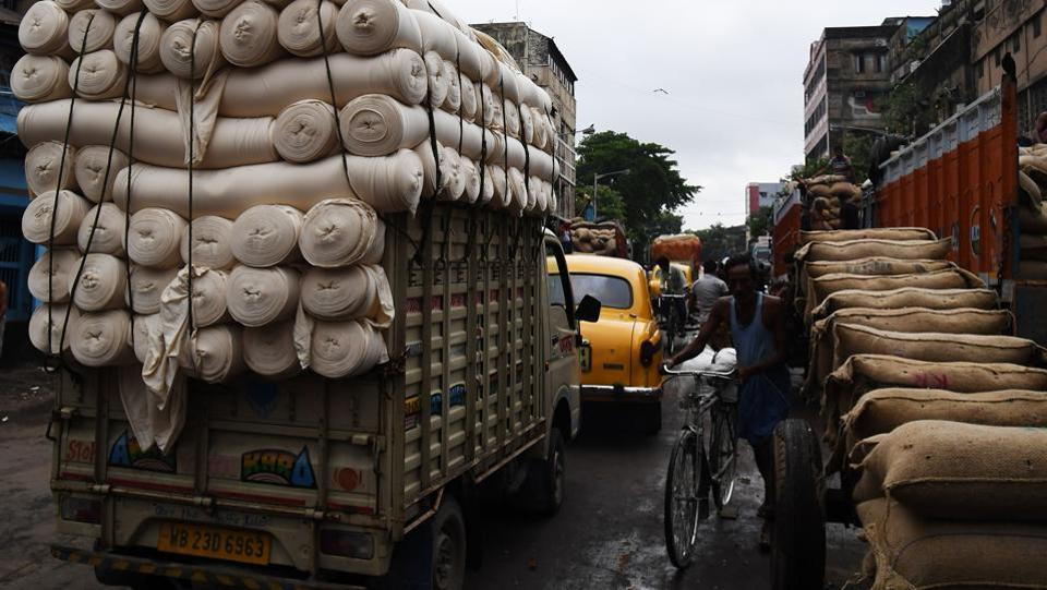 Under the new regime, companies will have to  file a tax return in every state they pass through -- a nightmare for a trucking company shipping goods nationwide. (Dibyangshu Sarkar / AFP)