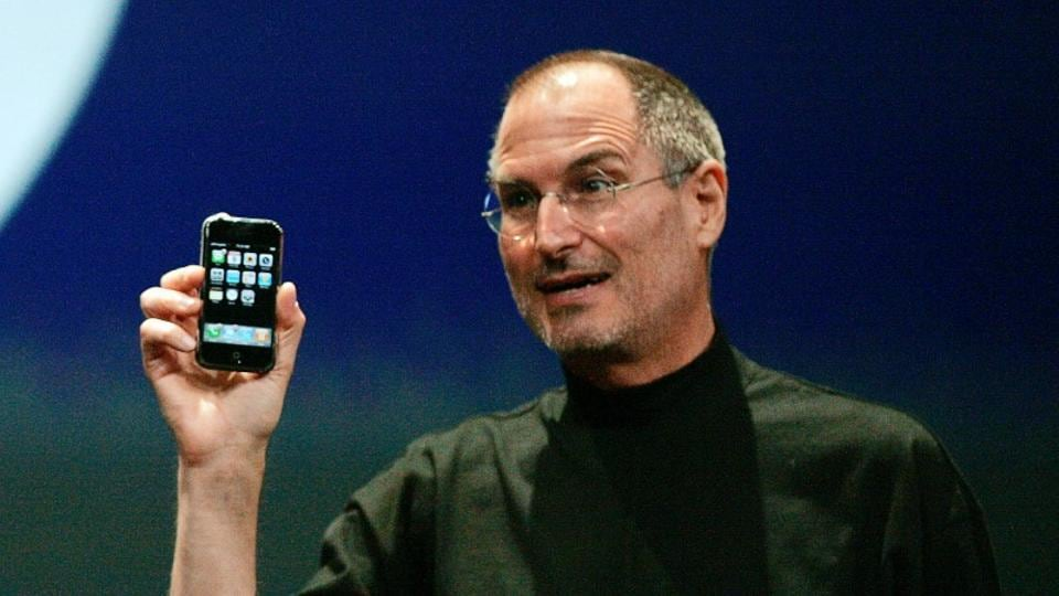 Then Apple Chief Executive Officer Steve Jobs holds the new iPhone in San Francisco, California January 9, 2007.