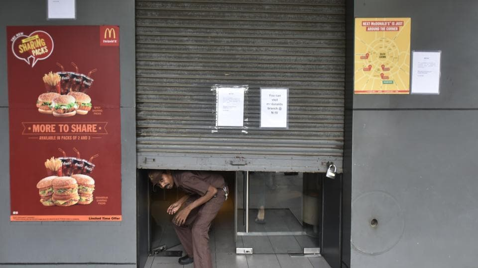 McDonald's outlet being shut down in New Delhi on Thursday.