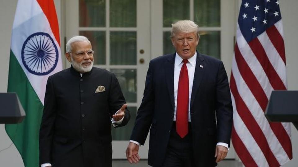 US President Donald Trump (R) with Prime Minister Narendra Modi in Washington.