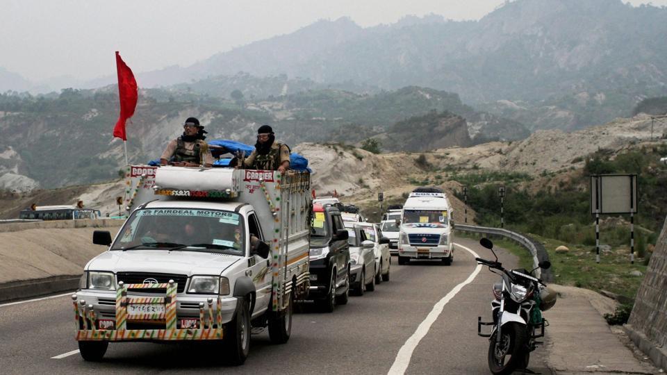 A security vehicle escorts the first batch of Amarnath pilgrims, on way to the holy shrine, at Jammu-Srinagar national highway near Jammu on June 28, 2017.