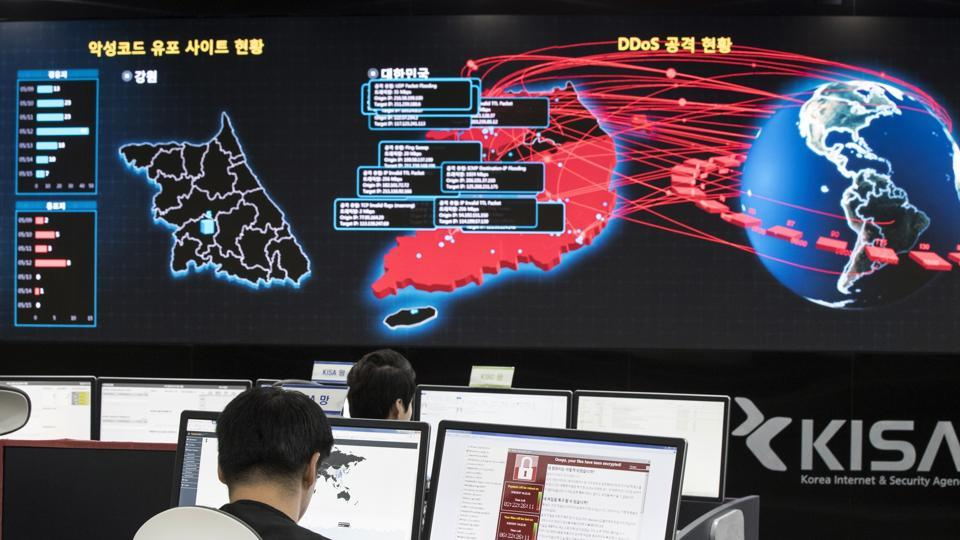Employees watch electronic boards to monitor possible ransomware cyberattacks at the Korea Internet and Security Agency in Seoul, South Korea