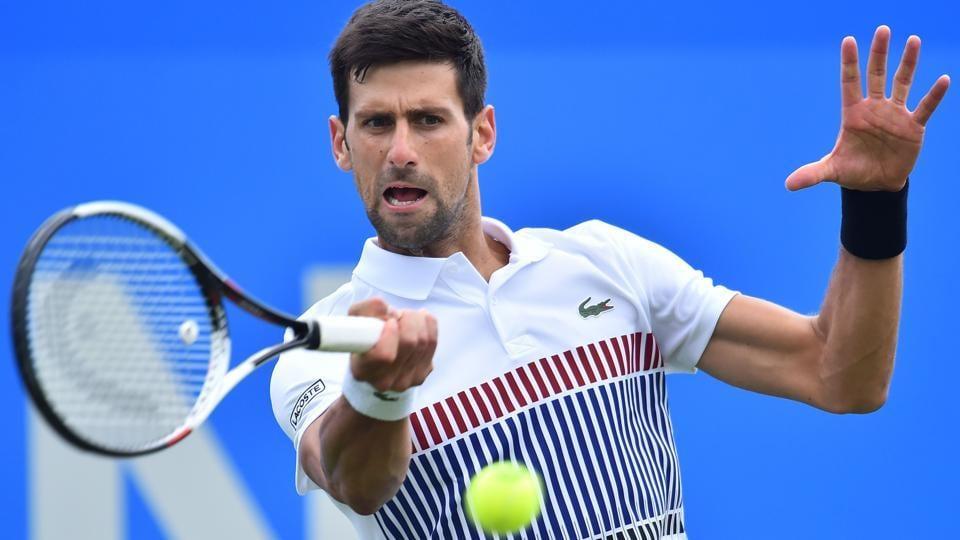 Novak Djokovic returns to Donald Young at the ATP Aegon International tennis tournament in Eastbourne.