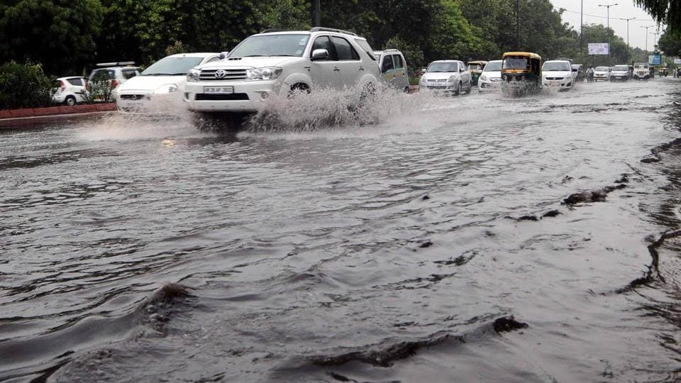Vehicles on a waterlogged road near Pragati Maidan in New Delhi.