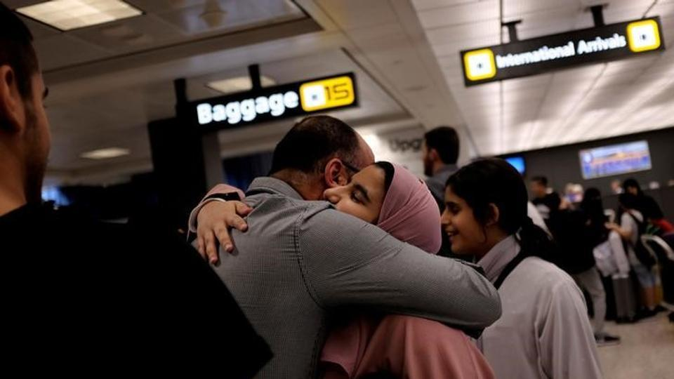 A Saudi family embraces as members arrive at Washington Dulles International Airport after the US Supreme Court granted parts of the Trump administration's emergency request to put its travel ban into effect later in the week pending further judicial review, in Dulles, Virginia, US.