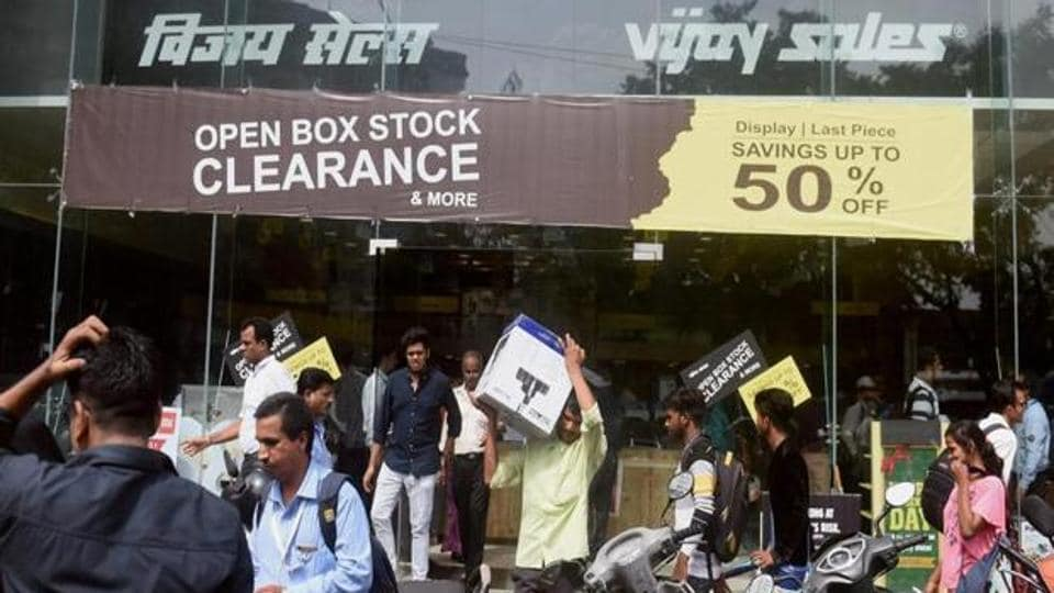 Garment stores were offering steep discounts on Friday to clear inventory before GST launch.