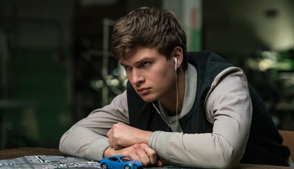 The pitch-perfect script captures the dilemma of a baby-faced driver (Ansel Elgort)  in the employ of a professional thief, who is never without his ear-buds connected to an iPod.