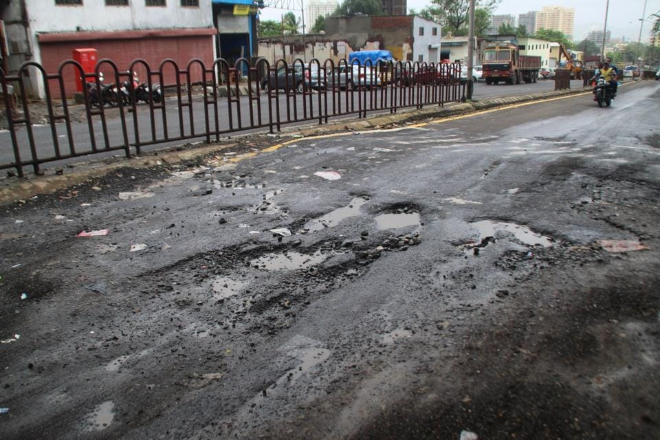 A pothole-ridden road at Majiwada junction in Thane.