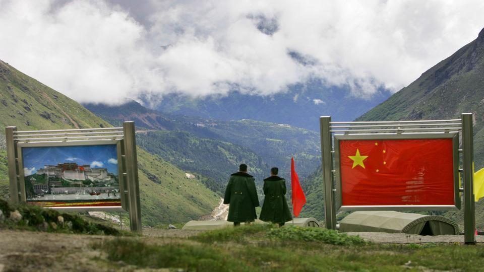 Chinese army officers oversee preparations as they stand on the Chinese side of the frontier at Nathu La along India's northeastern border in Sikkim.