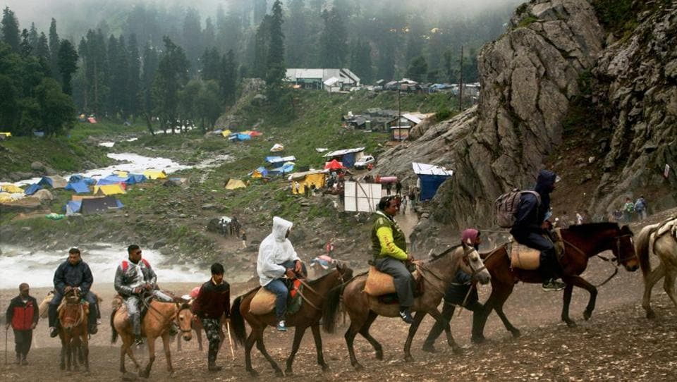 Amarnath pilgrims proceed towards the holy cave shrine at Chandanwari in south Kashmir on Thursday.