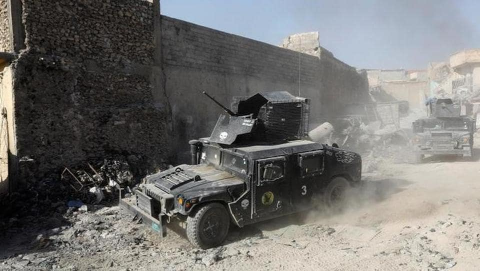 Armoured fighting vehicles of the Counter Terrorism Service manoeuvre at the positions of the Iraqi forces near the Grand al-Nuri Mosque at the Old City in Mosul, Iraq.
