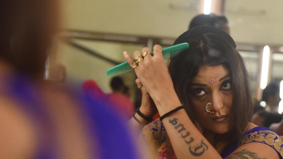 (A bold make-up, especially of the eyes and hair forms a big part of preparation for the performance. (Pratham Gokhale/HT Photo))