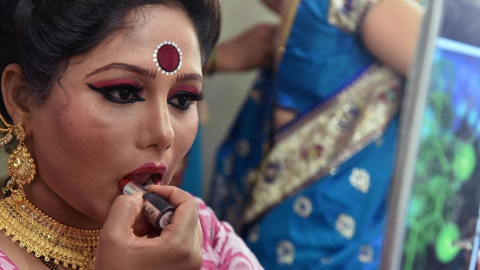 (And adding to the beauty are the special elements of the make-up. Here, a performer applies lipstick at the Bal Gandharva Rangmandir during the Lavani festival. (Pratham Gokhale/HT Photo))