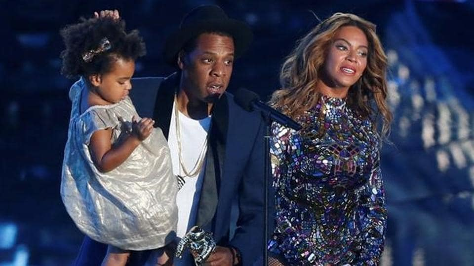 Jay-Z presents the Video Vanguard Award to his wife Beyonce as he holds their daughter Blue Ivy during the 2014 MTV Video Music Awards in Inglewood.