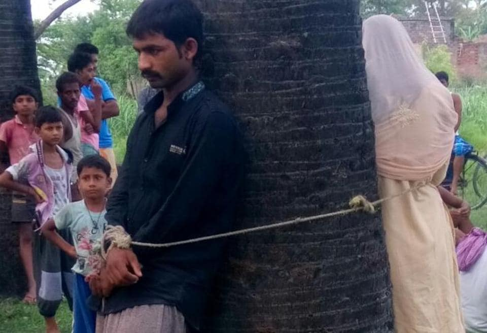 The woman and her paramour tied to tree in Bihar's Muzaffarpur district.