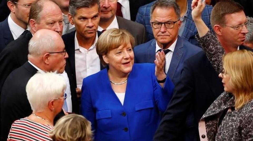 German Chancellor Angela Merkel gestures as members of the lower house of parliament Bundestag vote on legalising same-sex marriage, in Berlin, June 30, 2017.