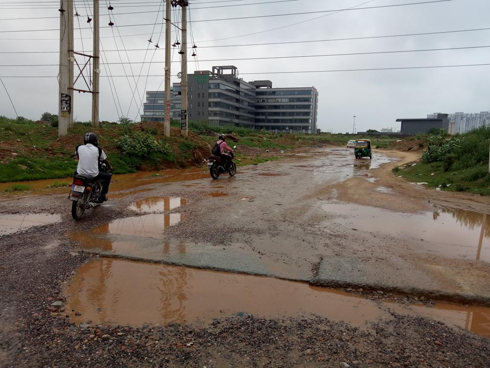 The road connecting Sector 65 to Golf Course Road is riddled with potholes.
