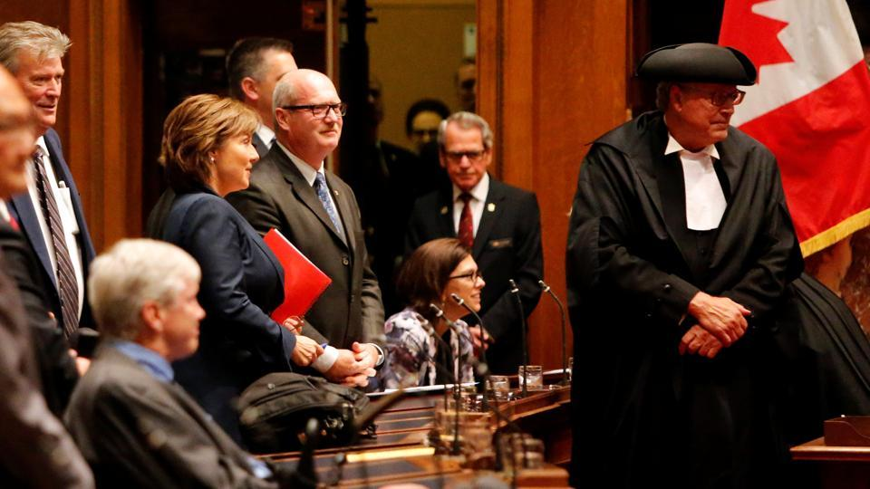 British Columbia Premier Christy Clark prepares to leave the legislative chamber after being defeated in a non-confidence vote in Victoria, B.C., Canada.