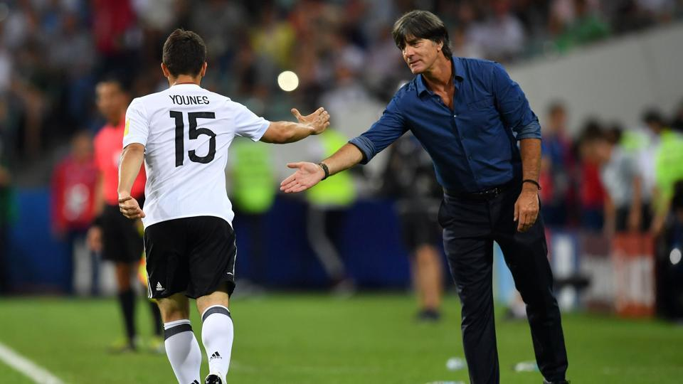 Germany's midfielder Amin Younes celebrates with Germany's coach Joachim Loew after scoring during the 2017 Confederations Cup semi-final against Mexico.