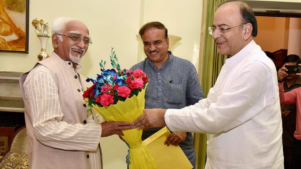 Finance minister Arun Jaitley and parliamentary affairs minister Ananth Kumar greet Vice President Hamid Ansari in New Delhi.