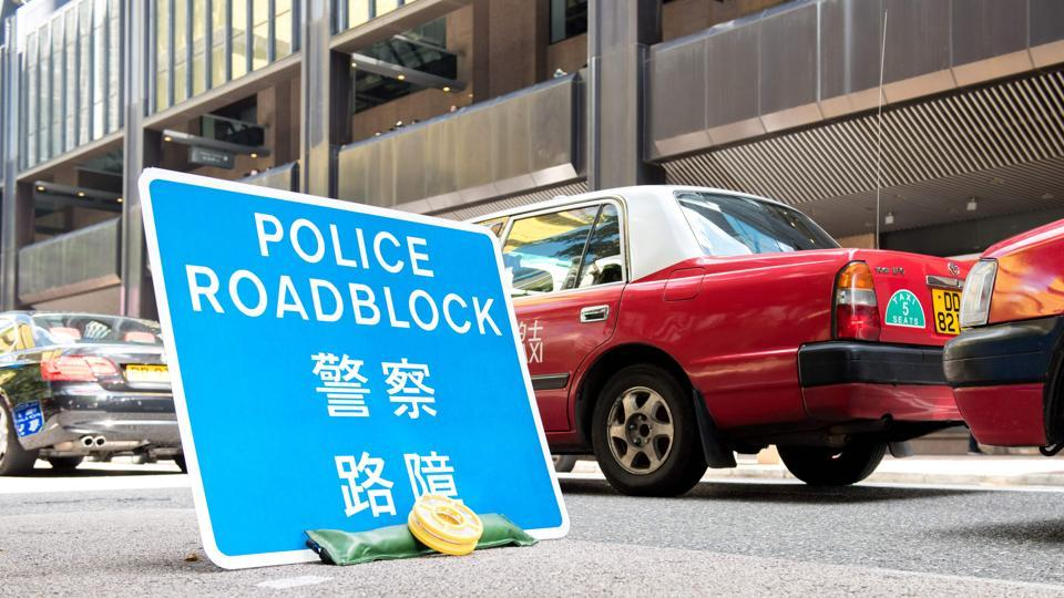 A police roadblock sign is placed in the area where Chinese President Xi Jinping is staying during his visit in Hong Kong on June 30, 2017.