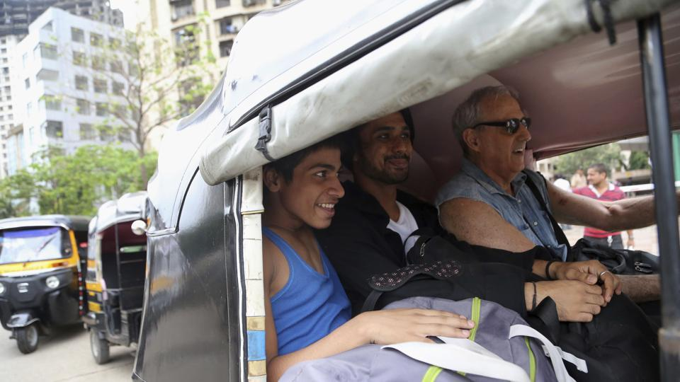 Amiruddin Shah(L) leaves with his  instructor(R) in an auto rickshaw after a practice session in Mumbai. Shah hopes for a  professional contract that would see him perform in ballets worldwide and help transform the lives of his parents and seven siblings who he says have often struggled to afford food.  (AP)